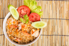Special Shrimp fried rice in black cup. Special Shrimp fried rice in white cup on table with wooden background Stock Photos