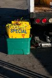 Special signs in tub for advertising goods at the local swap meet. Vendor is unloading his truck hoping for a successful day at the swap meet. He has his eye royalty free stock photo