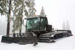Special snow vehicle - ratrak or snowcat. Serving winter resort Stock Images