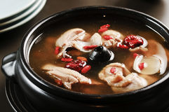 Special soup of chicken and olive herbs in black stew Royalty Free Stock Images