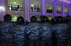 Special squad police. The special squad police surrounds participants in an unauthorized demonstration on Nevsky Prospekt, St. Petersburg Stock Image