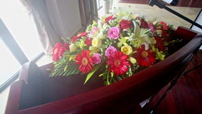 Special table with greeting bouquet at restaurant entrance stock footage