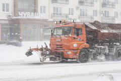 Special technique removes the snow from the street during a snow storm in poor visibility. Snow storm in the city of Cheboksary, C Stock Photo