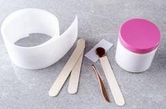 Special tools for hot depilation.Professional kit for waxing procedure stock photo