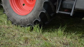 Special tractor equipment collect gather hay in field stock video footage