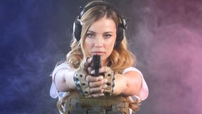 Woman soldier in military uniform developing her shooting skills. Slow motion stock video footage
