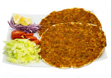 Special Turkish Pizza. 'Lahmacun' (Turkish Pizza) served with lettuce, tomato, onion and lemon on white background Stock Photos