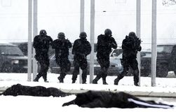 Special unit in action. Special force in counter terrorist operation on winter day royalty free stock photos