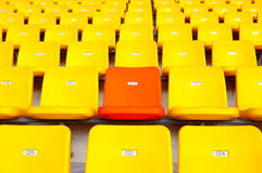 Special VIP seats seats. Stadium seating and a lot of yellow and a red seat Royalty Free Stock Photography