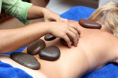 Special volcanic stone massage. Session at a spa center Stock Photos