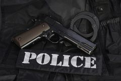 Special weapons and tactics police team equipment on black. Background Royalty Free Stock Photography
