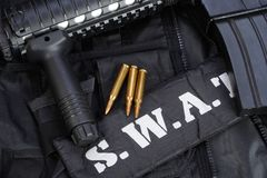 Special weapons and tactics team equipment. On black background Royalty Free Stock Photo