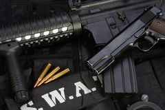 Special weapons and tactics team equipment on black. Background Royalty Free Stock Photo
