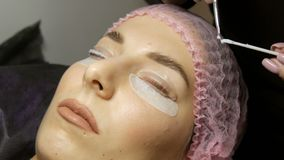 Special wellness mixture and molecular restoration on eyelashes close up view. Professional procedure for lamination and