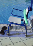 Special wheelchair to enter the pool for rehabilitative gymnasti Royalty Free Stock Images