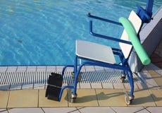 Special wheelchair to enter the pool for rehabilitative gymnasti Stock Image
