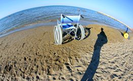 Special wheelchairs for disabled people with steel wheels Royalty Free Stock Images