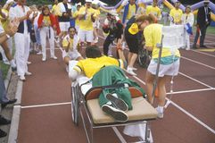 Speciale Olympics atleet op brancard Stock Foto