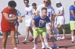 Speciale Olympics atleten bij beginlijn Stock Fotografie