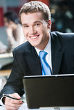 Specialist. Image of handsome specialist with smile in the cafe royalty free stock photos