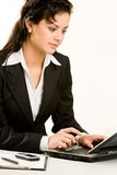 Specialist. Portrait of smiling professional sitting at the table and typing letter Royalty Free Stock Image