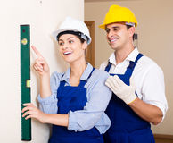 Specialist and assistant working with wall in new building Stock Photos
