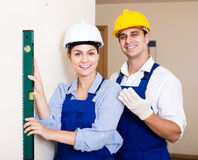 Specialist and assistant working with wall in new building Royalty Free Stock Image