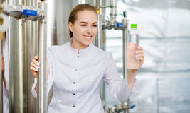 Specialist with bottle of pure water Royalty Free Stock Photos