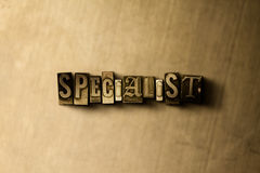 SPECIALIST - close-up of grungy vintage typeset word on metal backdrop Royalty Free Stock Photography