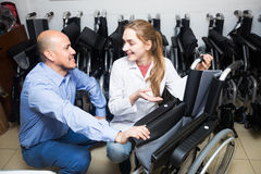 Specialist consulting client about wheelchairs Stock Image
