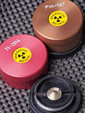 Specialist containers, one opened, containing radioactive isotopes Promethium and Thallium Stock Photos