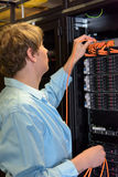 IT specialist controlling server in datacenter Stock Photos