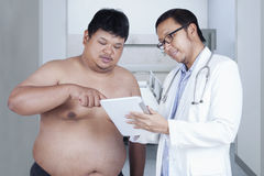 Specialist doctor with overweight patient Royalty Free Stock Image