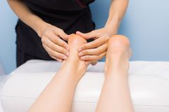 The specialist does a massage to the client of the massage cabin royalty free stock photo