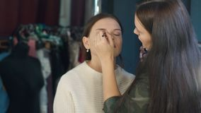 Specialist doing makeup for model. stock video