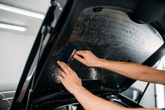 Specialist with drier, tinting film installation Stock Images