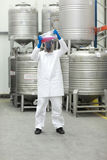 Specialist examining liquid in plastic container Royalty Free Stock Photo