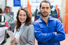 Specialist expert and mechanic at the garage Stock Photos