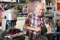 Specialist fixing heel taps Stock Photography