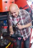 Specialist fixing heel taps Stock Images