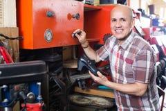 Specialist fixing heel taps Royalty Free Stock Image