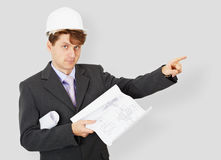 Specialist in helmet with drawing Stock Photo