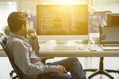 It specialist. Indian It specialist working in sunny office stock images