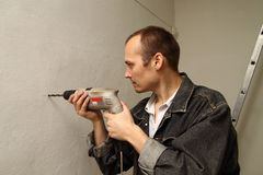 Specialist makes repairs. Royalty Free Stock Photo