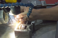 The specialist operator use the laser welding machine. Stock Photography