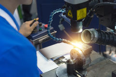 The specialist operator use the laser welding machine. The hi-precision welding process Royalty Free Stock Images