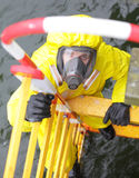 Specialist in protective suit and mask on ladder Royalty Free Stock Photos