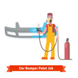 Specialist spray painting auto bumper Royalty Free Stock Photos