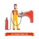 Specialist spray painting auto fender Stock Image