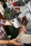 Specialist stitching shoes Stock Image